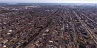 Aerial panorama over the muddy streets of Chalmette after Katrina.